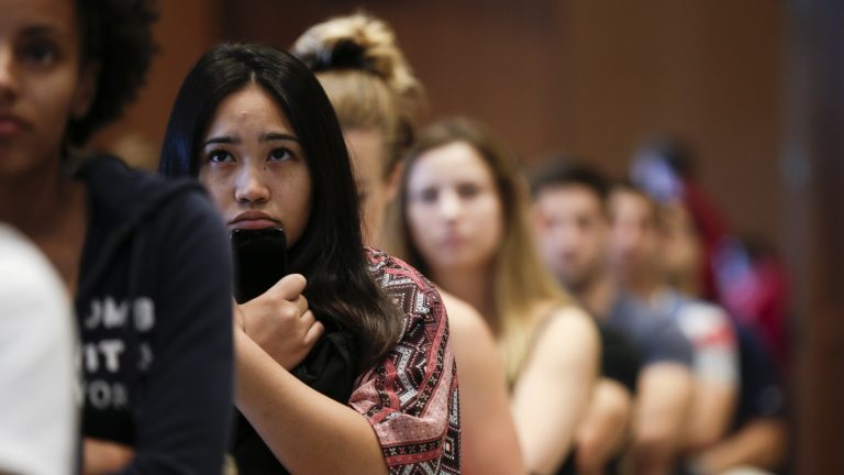 New students at San Diego State University watch a video on sexual consent during an August orientation meeting in San Diego. Defining consensual sex is a growing trend by universities under pressure to do more to protect victims.  (Gregory Bull/AP Photo)
