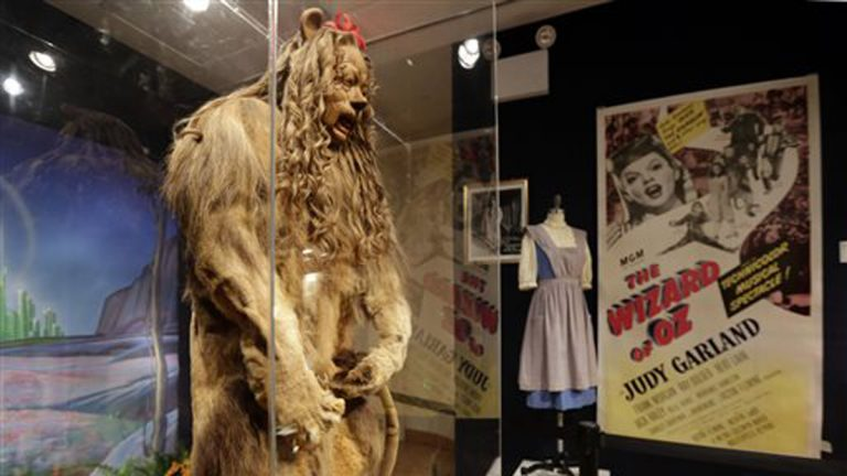 This Nov. 21, 2014 photo shows Bert Lahr's Cowardly Lion costume and a three-sheet poster from