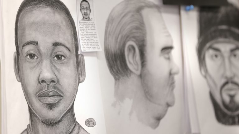 A sketch by police officer Matthew Klein of an unidentified man who committed suicide is displayed above Klein's work station in the NYPD Artist Unit in New York. (Seth Wenig/AP Photo)