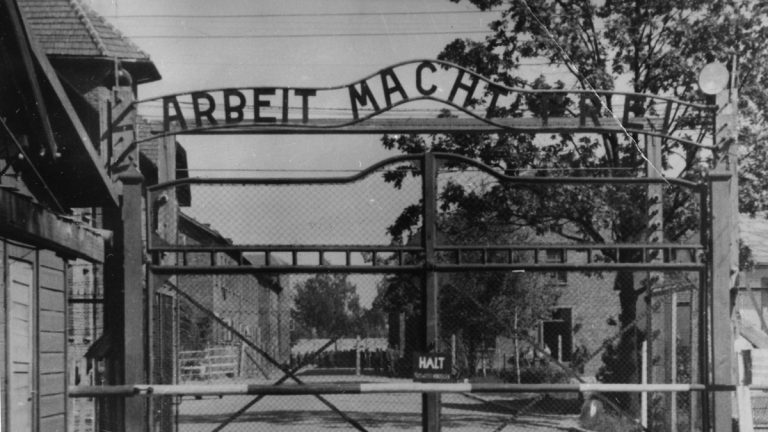This undated file image shows the main gate of the Nazi concentration camp Auschwitz I in Poland, which was liberated by the Russians in January 1945. Writing over the gate reads: 'Arbeit macht frei' (Work Sets You Free). Germany has launched a war crimes investigation against an 87-year-old Philadelphia man it accuses of serving as an SS guard at the Auschwitz death camp, following years of failed U.S. Justice Department efforts to have the man stripped of his American citizenship and deported. Johann 'Hans' Breyer, a retired toolmaker, admits he was a guard at Auschwitz during World War II, but told the AP he was stationed outside the facility and had nothing to do with the wholesale slaughter of some 1.5 million Jews and others behind the gates. (AP Photo, file)