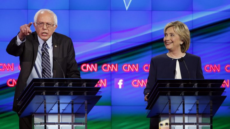 Sen. Bernie Sanders, of Vermont, (left), speaks as Hillary Rodham Clinton looks on during the CNN Democratic presidential debate Tuesday, Oct. 13, 2015, in Las Vegas. (John Locher/AP Photo)