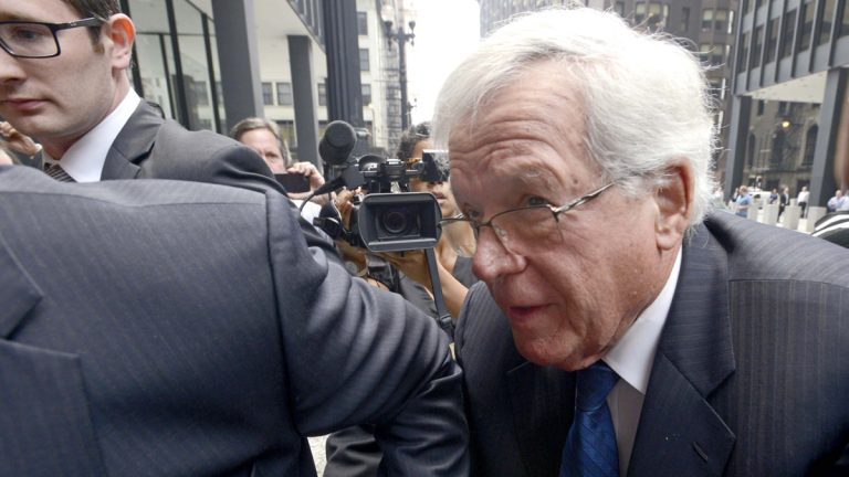 In this June 9, 2015 file photo, former House Speaker Dennis Hastert arrives at the federal courthouse, in Chicago for his arraignment on federal charges that he broke federal banking laws and lied about the money when questioned by the FBI. The federal judge assigned to the case against Hastert will continue to preside over it after disclosing connections to the former U.S. House Speaker and several attorneys. Prosecutors and lawyers for Hastert filed paperwork Thursday, June 11, 2015, saying they're willing to have U.S. District Judge Thomas M. Durkin remain on the case. (Paul Beaty/AP Photo)