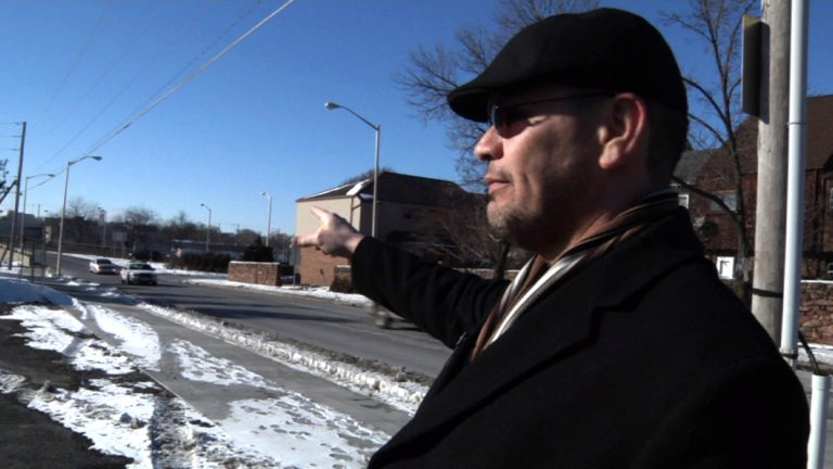 In this image from a Jan. 29, 2014 video, Ricardo Nieves stands in a parking lot where he says he was stopped and motions in the direction he says he'd been driving from during the National Roadside Survey of Alcohol and Drugged Driving on Dec. 13, 2013 in Reading, Pa. Nieves filed a federal lawsuit over the survey, saying his rights were violated when a government contractor forced him into the parking lot, where he was questioned about his driving habits and asked to provide a saliva sample. (Michael Rubinkam/AP Photo)
