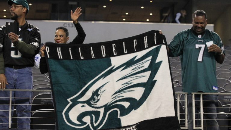 Unidentified Philadelphia Eagles fans wave to the team following an NFL football game against the Dallas Cowboys, Thursday, Nov. 27, 2014, in Arlington, Texas. The Eagles won 33-10. (AP Photo/John F. Rhodes)
