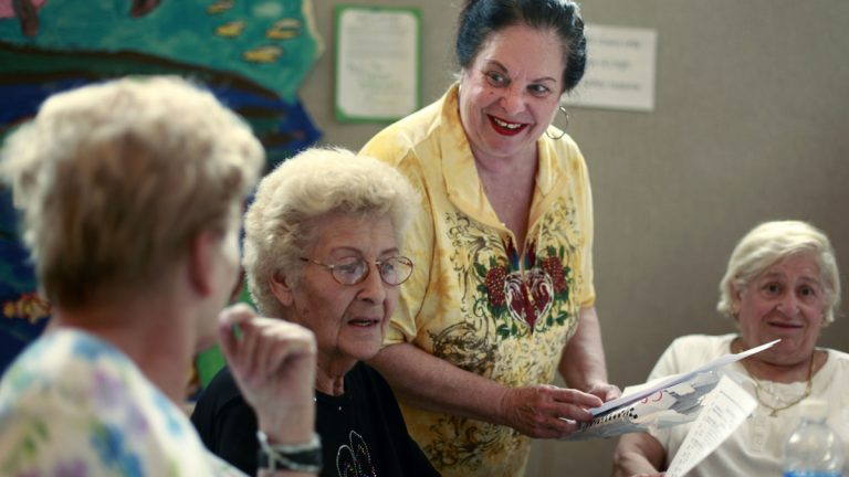 Social worker Roberta Marzano with Caring People Alliance speaks with seniors at the Fels South Philadelphia Community Center in Philadelphia, Wednesday, Aug. 12, 2009. (Matt Rourke/AP Photo)