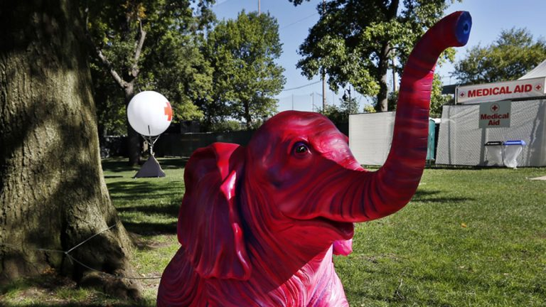 A pink elephant sculpture sits adjacent to a medical tent at the Electric Zoo music festival venue on New York's Randall's Island, Friday, Aug. 29, 2014. The final day of last year's festival was called off after two people died from an overdose of MDMA combined with hyperthermia. (Jason DeCrow/AP Photo)