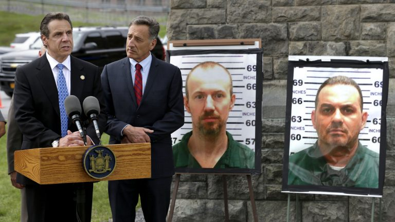 New York Governor Andrew Cuomo, (left), speaks while Vermont Governor Peter Shumlin listens during a news conference in front of the Clinton Correctional Facility in Dannemora, N.Y., Wednesday, June 10, 2015.  Police were resuming house-to-house searches near the maximum-security prison in northern New York where David Sweat and Richard Matt, two killers escaped using power tools, authorities said Wednesday as they renewed their plea for help from the public. (Seth Wenig/AP Photo)