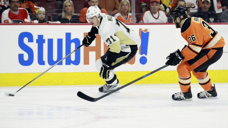Pittsburgh Penguins' Evgeni Malkin, left, is trailed by Philadelphia Flyers' Zac Rinaldo in the first period of an NHL hockey game Sunday, April 5, 2015, in Philadelphia. (Tom Mihalek/AP Photo)