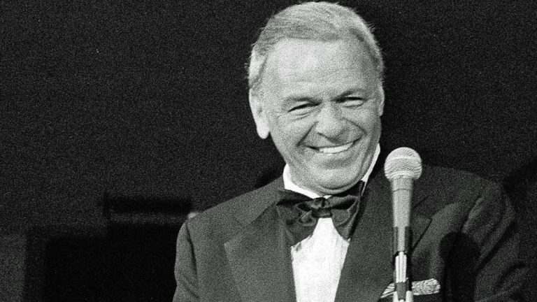 In this May 18, 1977 file photo, performer Frank Sinatra appears on the stage of the Westchester Premier Theater in Tarrytown, N.Y., during the opening night of his act with Dean Martin. (Ray Stubblebine/AP Photo, file)