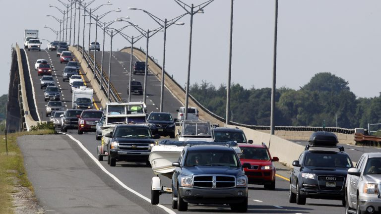 Sport utility vehicles pulling pleasure boats lead a line of traffic north on the Garden State Parkway across the Great Egg Harbor Bay Inlet Bridge near Ocean City, N.J., Aug. 26, 2011, as much of the Jersey shore evacuated inland ahead of Hurricane Irene. (Mel Evans/AP Photo)