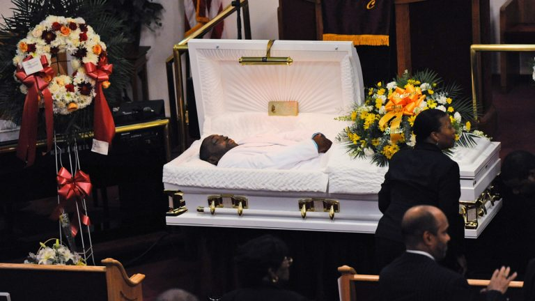 In this July 23, 2014 file photo, Eric Garner's body lies in a casket during his funeral at Bethel Baptist Church in the Brooklyn borough of New York. Garner died in police custody after an officer placed him in an apparent chokehold. Staten Island District Attorney Daniel Donovan announced Tuesday, Aug. 19, 2014, that an extra grand jury will be impaneled to hear evidence next month in the July 17 death of Garner. Donovan says his decision is based on his office's investigation and the medical examiner's ruling that the death was homicide. (AP Photo/New York Daily News, Julia Xanthos, Pool, File)