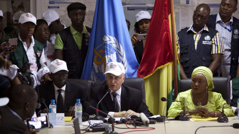Mohamed Belhocine (center), a representative from the World Health Organization,  speaks during a press briefing in Conakry, Guinea, last month. Guinea has been declared free from transmission of Ebola, the World Health Organization said Tuesday, marking a milestone for the West African country where the original Ebola chain of transmission began two years ago leading to the largest epidemic in history. (Youssouf Bah/AP Photo)