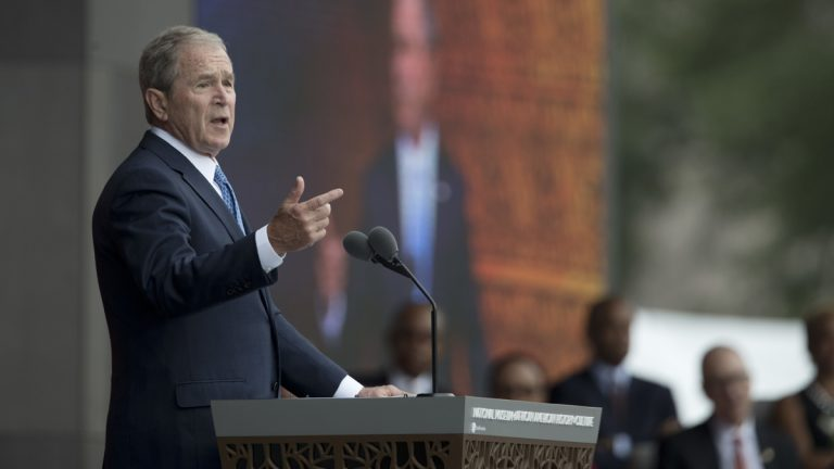 Former President George W. Bush speaks during the opening ceremony of the Smithsonian National Museum of African American History and Culture on the National Mall in Washington