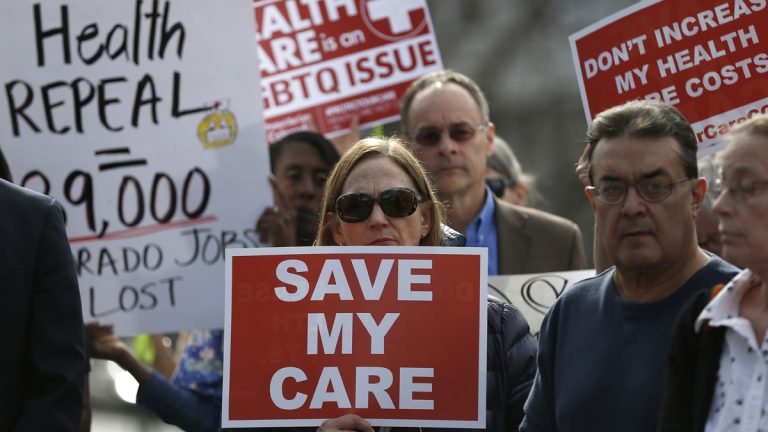 Supporters of the Affordable Care Act who are also opponents of Colorado's GOP-led plan to undo Colorado's state-run insurance exchange gather for a rally organized by the national Save My Care Bus Tour