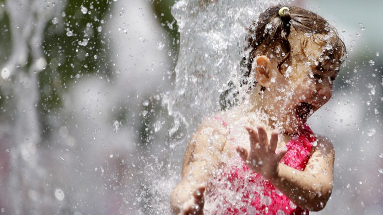 Jordyn Chin, 5, plays in the fountain at Dilworth Park Friday, June 12, 2015, in Philadelphia. (Matt Rourke/AP Photo)