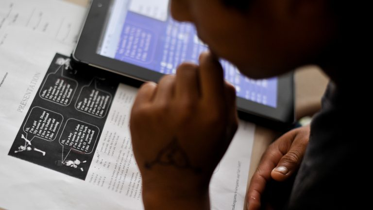A student in the Accelerating Preliterate English Language Learners class looks over a worksheet aimed at teaching basic introductions in English. The Supreme Court has ruled that U.SA. schools have an obligation to educate all students regardless of their immigration status. (Emily Varisco/AP Photo)