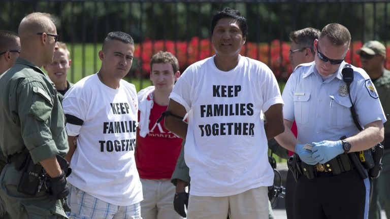 Demonstrators are arrested outside the White House in Washington, Thursday, Aug. 28, 2014, during a protest for immigration reform. (Evan Vucci/AP Photo)