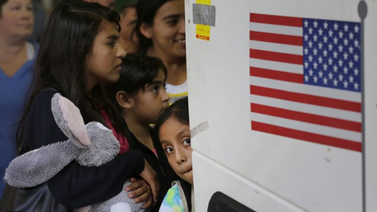 In this July 7, 2015 file photo, immigrants from El Salvador and Guatemala who entered the country illegally board a bus after they were released from a family detention center in San Antonio. A group of immigrant rights lawyers in a filing Thursday, Aug. 13, 2015, say that detention of women and children caught crossing the U.S.-Mexico border illegally is lengthy and unsafe, challenging the government's claims that immigrant families are held only briefly and that their detention doesn't violate a longstanding ban. (Eric Gay/AP Photo, File)
