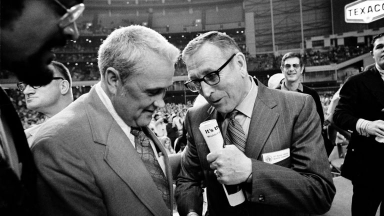 In this March 27, 1971, file photo, Villanova University basketball coach Jack Kraft (left) congratulates UCLA coach John Wooden after Wooden's Bruins defeated Villanova, 68-62, to win the NCAA championship in Houston, Texas. Villanova officials say former head basketball coach John 'Jack' Kraft died Thursday, Aug. 28, 2014, in New Jersey. He was 93. (AP Photo, file)