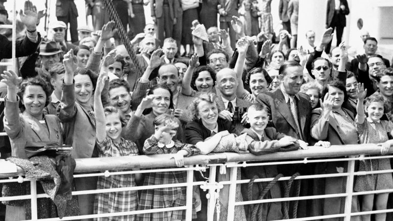 German Jewish refugees returned to Antwerp, Belgium, aboard the liner St. Louis after they had been denied entrance to Cuba. A small group of the 907 refugees are shown here, smiling in the face of their adversity, as they arrived at Antwerp after their long voyage on June 17, 1939 in Belgium. (AP Photo)