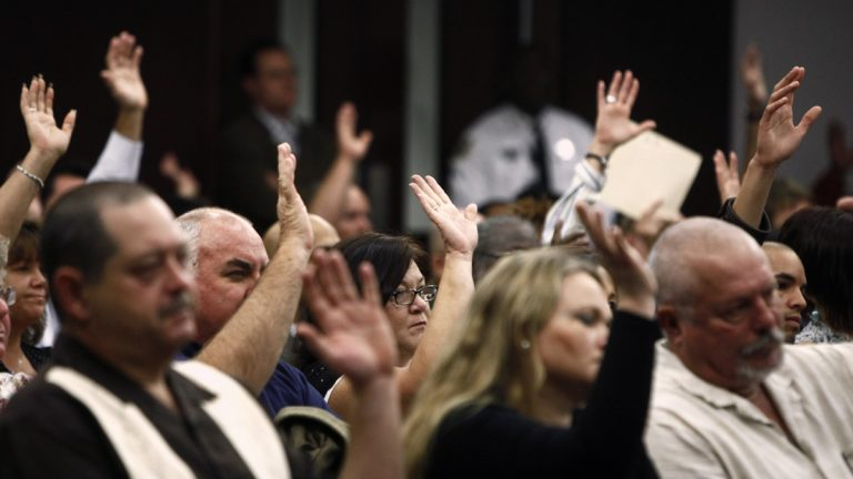 People raise their hands to affirm they would attend jury duty in January 2012 in response to Circuit Judge Gregory Holder, as he addresses residents who did not show up for jury duty in Tampa, Fla. The group of 246 people got a stern lecture on responsibility and a civics lessons from Judge Holder. (St. Petersburg Times, Skip O' Rourke/AP Photo, pool)