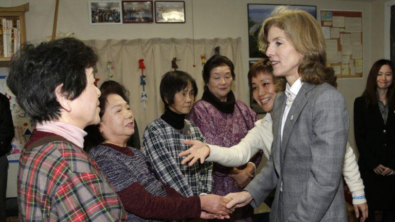 New U.S. Ambassador to Japan Caroline Kennedy is greeted by tsunami survivors in Minamisanriku, Miyagi Prefecture, northeastern Japan, Monday, Nov. 25, 2013. (Shizuo Kambayashi/AP Photo, file)