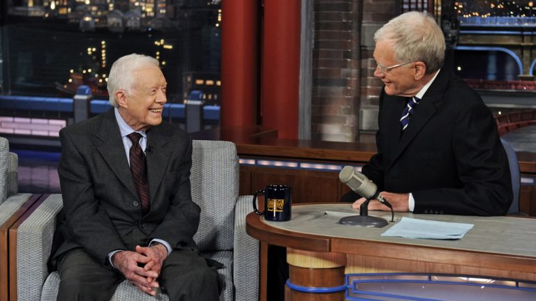 In this photo provided by CBS, former President Jimmy Carter, left, talks with David Letterman on