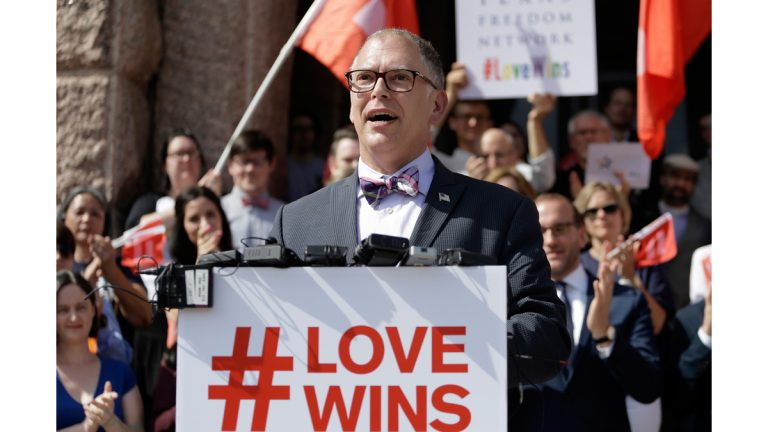 Jim Obergefell, the named plaintiff in the Obergefell v. Hodges Supreme Court case that legalized same sex marriage nationwide, is backed by supporters of the courts ruling on same-sex marriage on the step of the Texas Capitol during a rally Monday, June 29, 2015, in Austin, Texas. The Supreme Court declared Friday that same-sex couples have a right to marry anywhere in the United States. (Eric Gay/AP Photo)