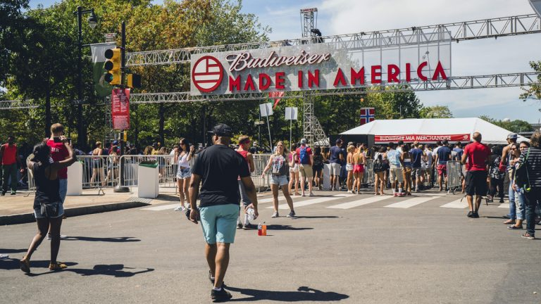 People walk into the Made in America festival on Sunday