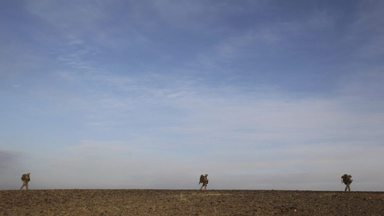 U.S. Marines patrol outside Marjah in Afghanistan's Helmand province. (David Guttenfelder/AP Photo