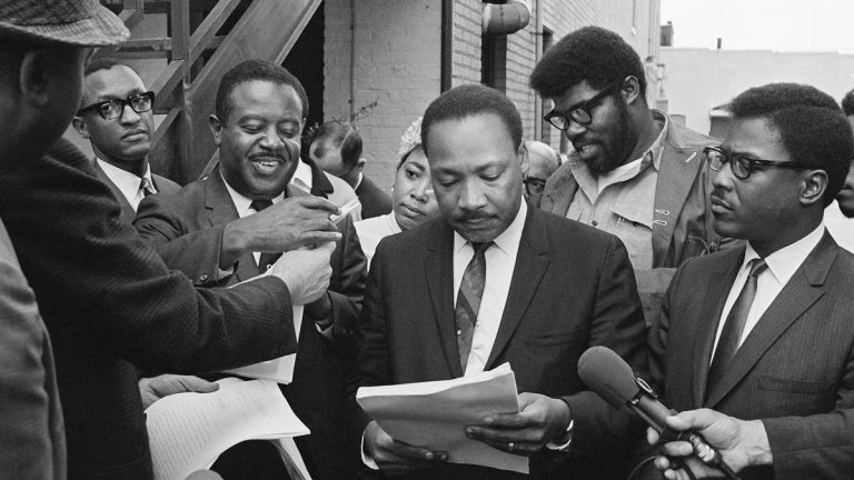 Civil rights leader Dr. Martin Luther King pictured on Thursday Apr. 3, 1968. King and his aides were being served papers by U.S. Marshal. A federal restraining order prohibited King from leading any mass marches. (AP Photo)