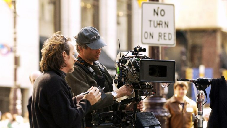 Crew members work with a Steadicam operator on a set for the movie filmed in Philadelphia (Michael Mergen/AP Photo, file)
