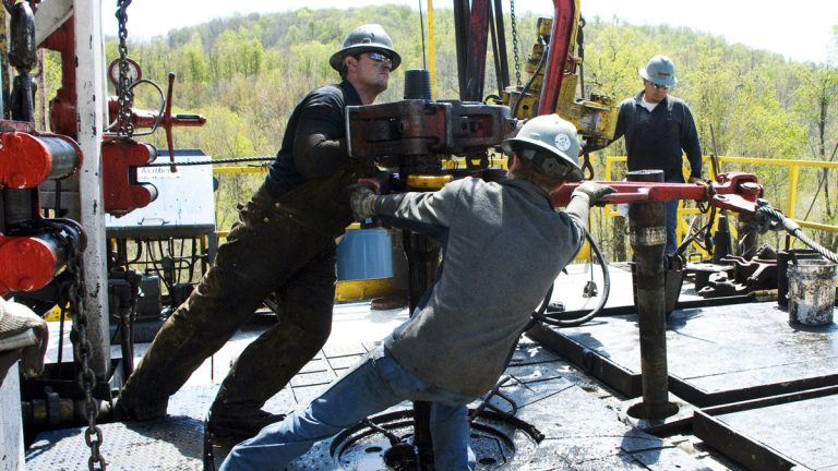 In this April 23, 2010 file photo, workers move a section of well casing into place at a Chesapeake Energy natural gas well site near Burlington, Pa., in Bradford County. (Ralph Wilson/AP Photo, file)