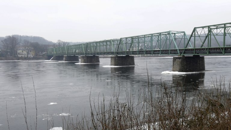 Traffic crosses the bridge into Lambertville