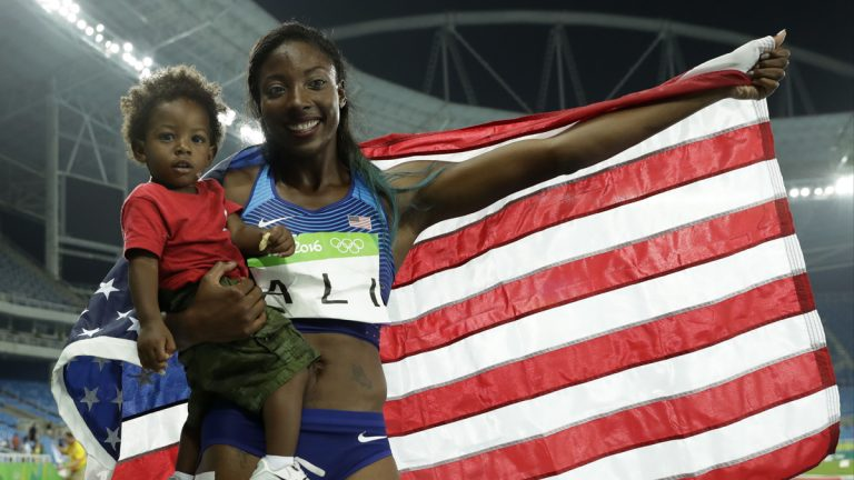 United States' silver medal winner Nia Ali poses with her 15-months old son Titus after the women's 100-meter hurdles final