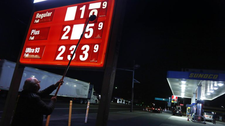 Leon Balagula changes the price for the gasoline at his Sunoco station in the early Tuesday morning in Fort Lee