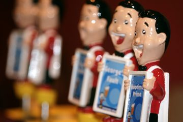 Caricatures top the beer taps of the offerings from Nodding Head Brewing Company of Philadelphia, Pa. New legislation would increase the amount of beer companies can sell and still be considered