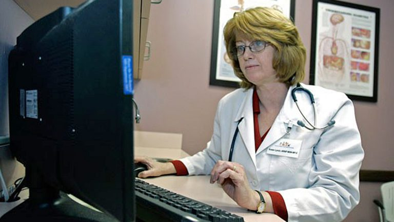 Susan Lynch, a nurse practitioner, checks over a patients electronic medical records (John Raoux/AP Photo)