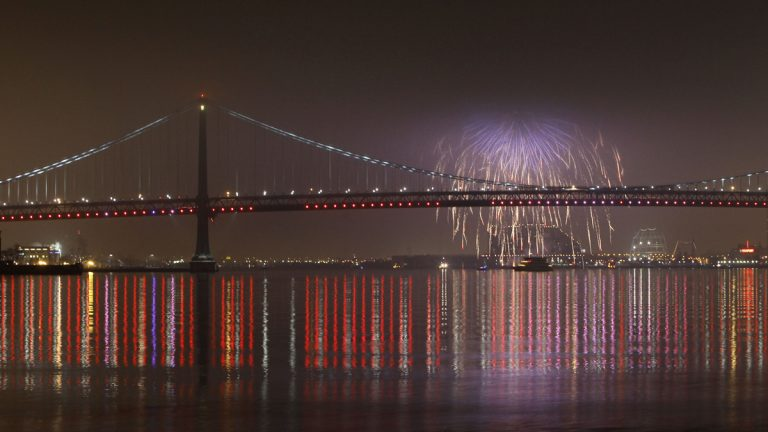 Fireworks explode in the foggy night sky above the Benjamin Franklin Bridge during a New Years celebration (Matt Slocum/AP Photo, file)