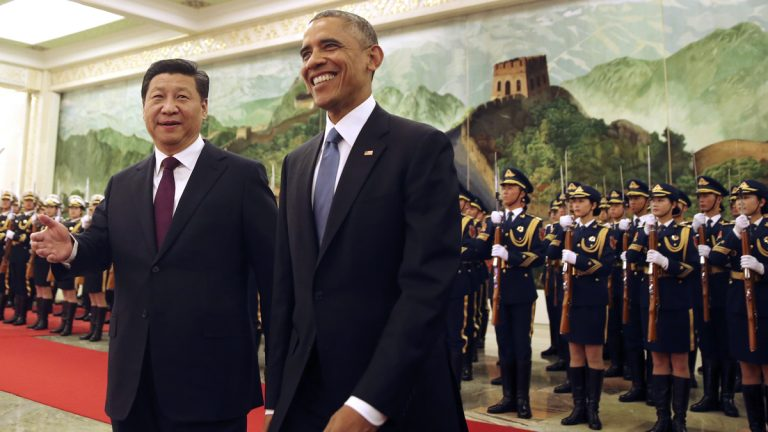 U.S. President Barack Obama smiles as he walks with Chinese President Xi Jinping during a welcome ceremony at the Great Hall of the People in Beijing Wednesday, Nov. 12, 2014. (Andy Wong/AP Photo)