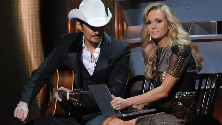 Hosts Carrie Underwood and Brad Paisley onstage