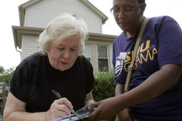 A Pennsylvania resident fills out a voter registration form outside a senior citizen's home (Keith Srakocic/AP Photo, file)