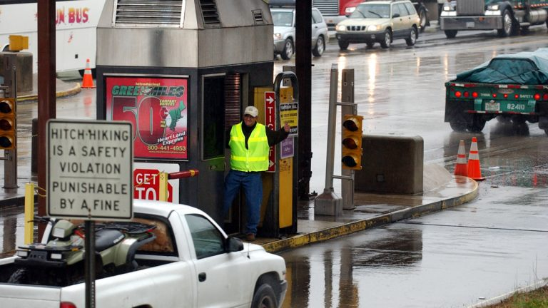 A toll worker gives a motorist a thumbs-up after waving a car past the ticket booth in Carlisle, Pa. (Carolyn Kaster/AP Photo)