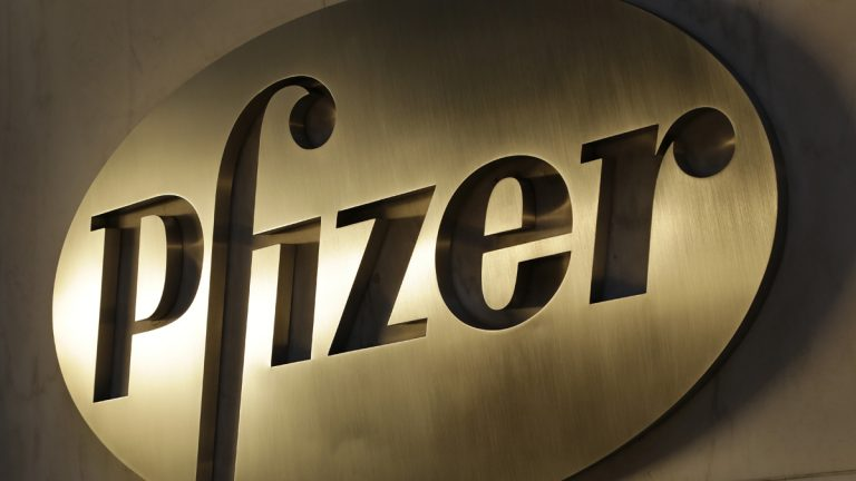The Pfizer logo is displayed at world headquarters, Monday, Nov. 23, 2015, in New York. Pfizer and Allergan will join in a $160 billion deal to create the world's largest drugmaker. (Mark Lennihan/AP Photo)