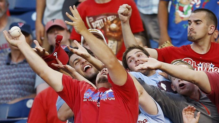 Fans reach for a foul ball hit by Philadelphia Phillies' Marlon Byrd during the third inning of a baseball game against the Miami Marlins, Tuesday, June 24, 2014, in Philadelphia. (Matt Slocum/AP Photo)