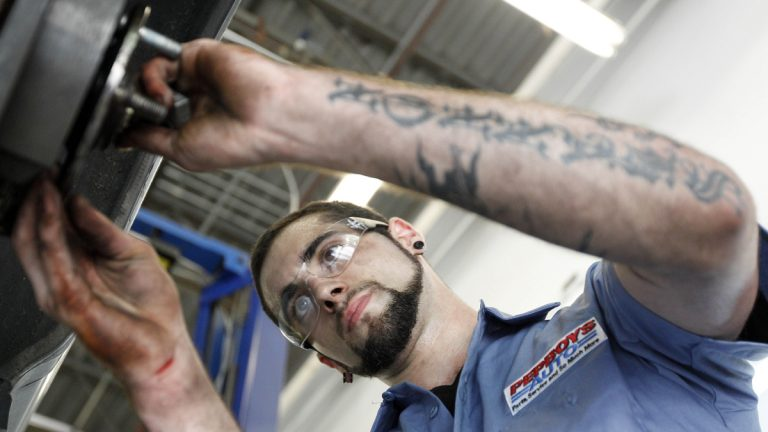 A technician works on a car at a Pep Boys Auto retail and service location, in Philadelphia. (Matt Rourke/AP Photo, file)