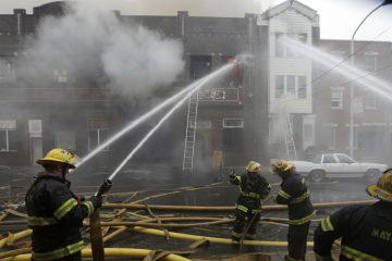 Firefighters battle a fire in Philadelphia (Matt Rourke/AP Photo, file)