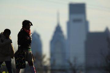 People walk in view of the city skyline in Philadelphia (Matt Rourke/AP Photo)