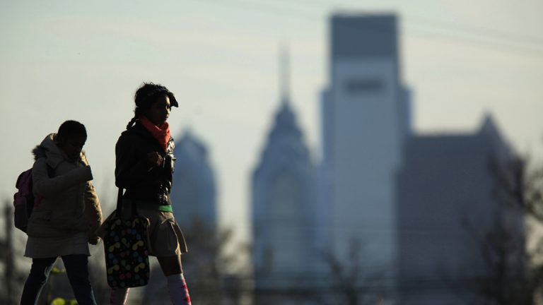 People walk in view of the city skyline in Philadelphia (Matt Rourke/AP Photo)