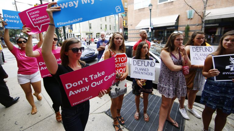 Opponents and supporters of Planned Parenthood demonstrate last month in Philadelphia. (Matt Rourke/AP Photo)